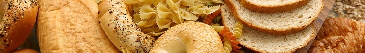 olika sorters brod och pasta och andra kolhydratsrika matprodukter