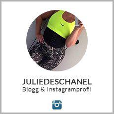 julie deschanel i ett neongront linne med en waist trainer mot vit bakgrund