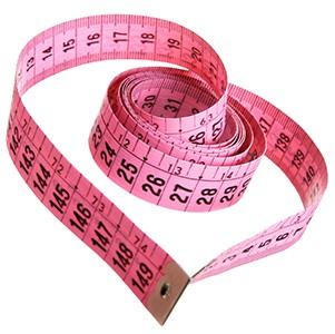 ett rosa mattband ar format som ett hjarta mot en vit bakgrund